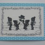 Scherenschnitt Postkarte Kinder im Schnee